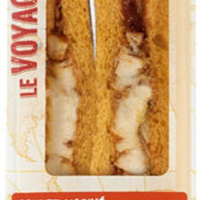 Sandwich au pain mie spécial tex mex garni de filet de poulet mariné,d'une sauce tomate épicée et de salade (U)